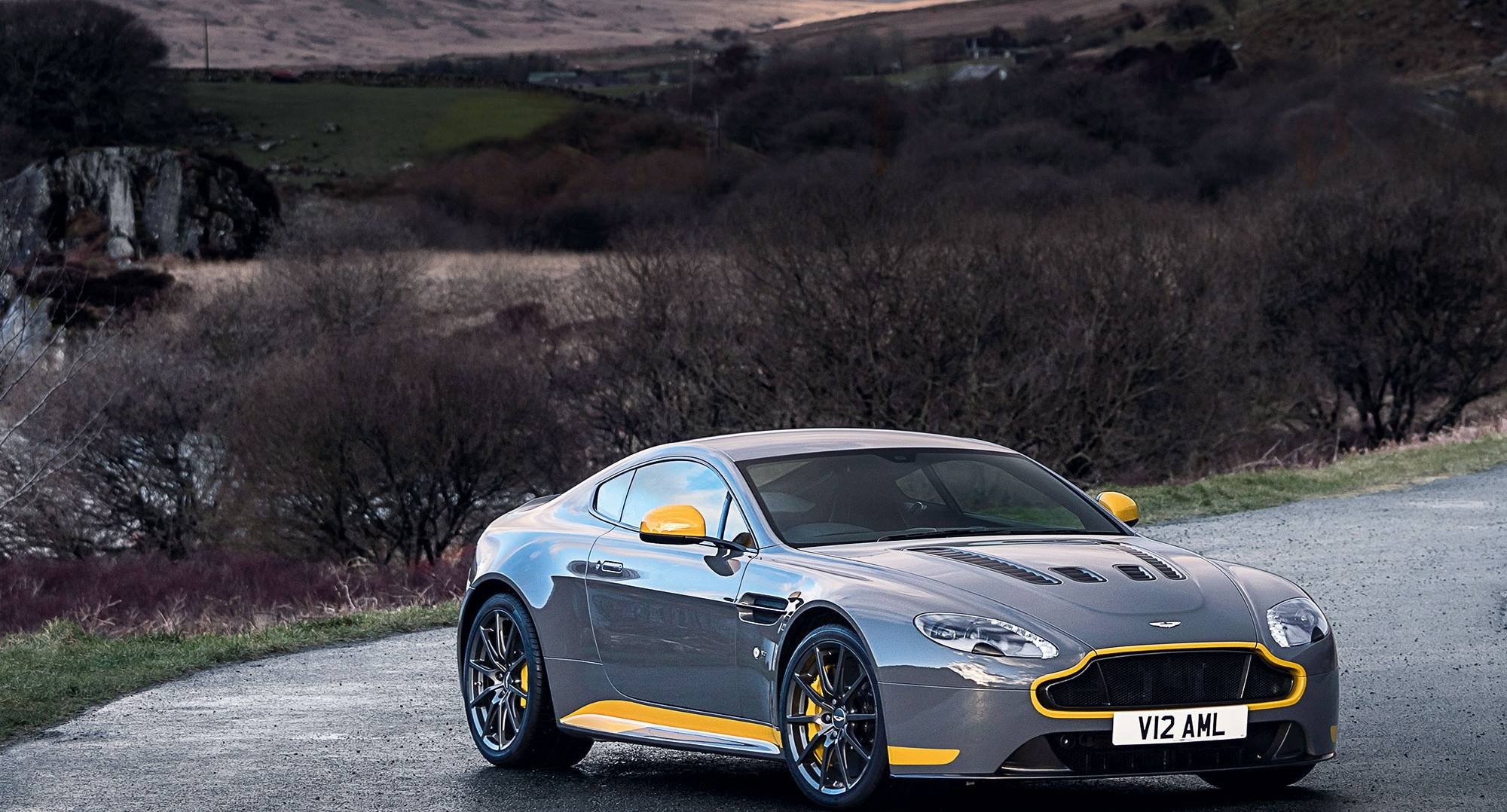 The Aston Martin V12 Manual parked on a road in the Warwickshire countryside