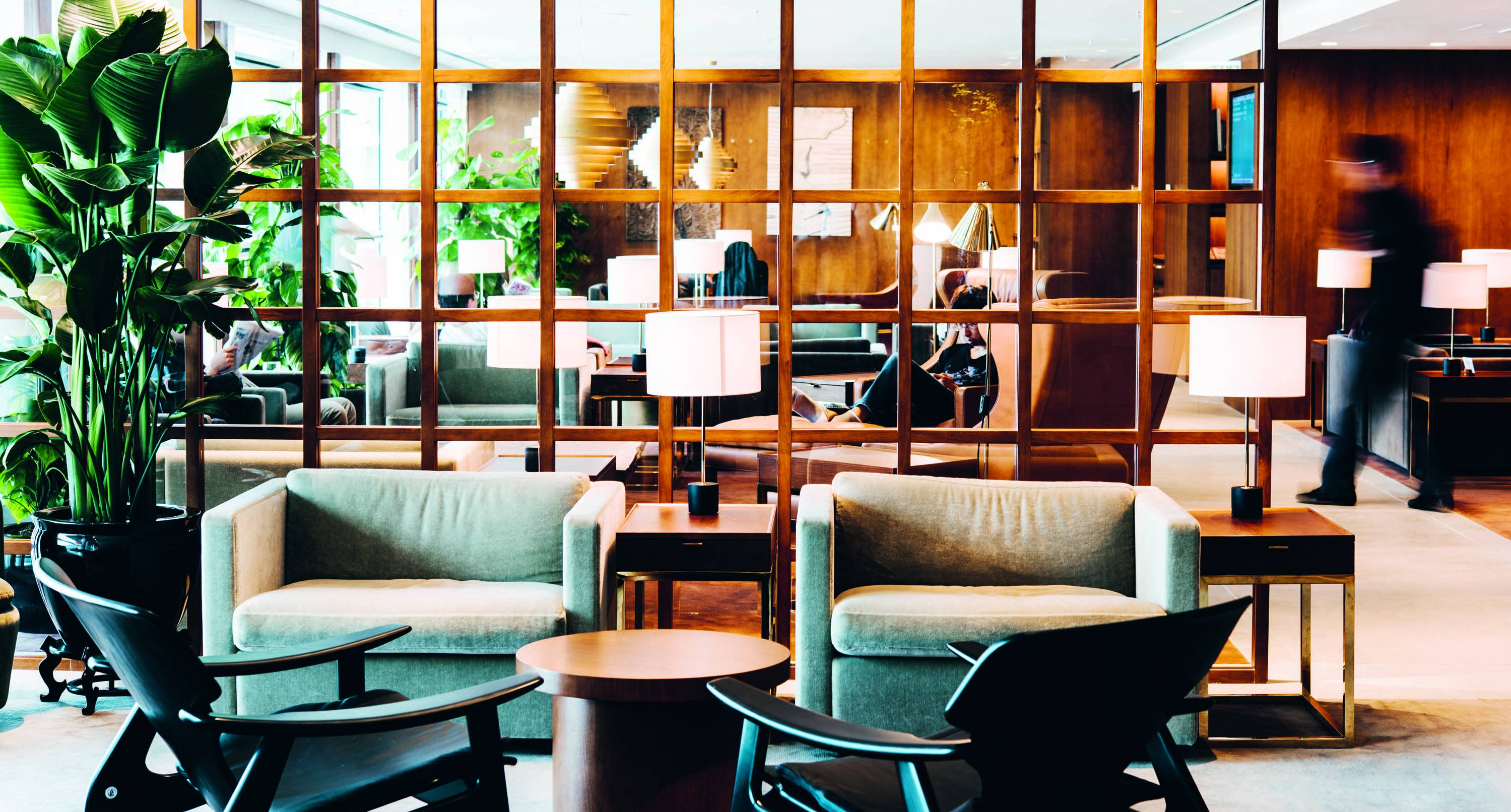 For cathay pacifics business lounge in hong kong crawford used plush natural materials such as cherry wood bronze and leather to create a cool