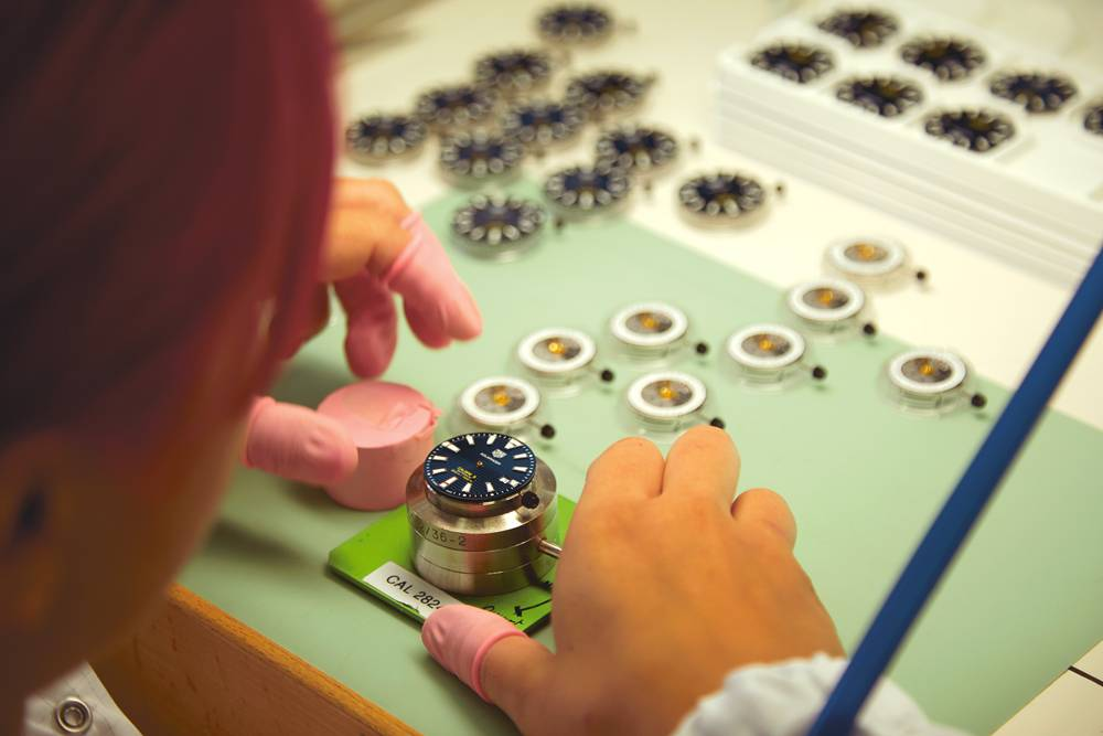 Staff work by hand in the TAG Heuer factory